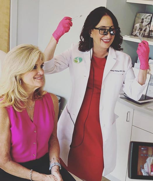 SpringhouseDerm: Smiling female patient with happy Dr. Margo Weishar